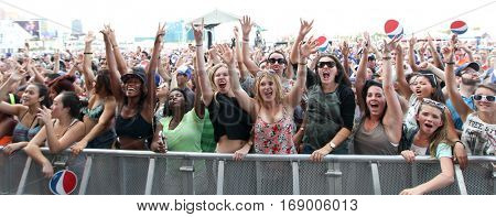 LAS VEGAS-SEP 20: Fans cheer at the iHeartRadio Music Festival Village Show at MGM Resorts Village on September 20, 2014 in Las Vegas, Nevada.