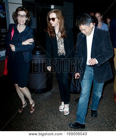 NEW YORK, NY-JUL 30: Actress Isabelle Huppert (C) arrives at the Walter Reade Theater for