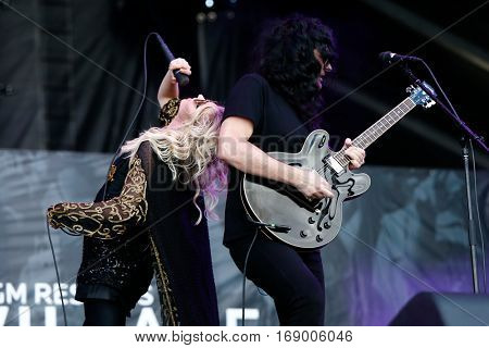 LAS VEGAS-SEP 20: Singer Taylor Momsen (L) and Ben Phillips of The Pretty Reckless perform at iHeartRadio Music Festival Village Show at MGM Resorts Village on September 20, 2014 in Las Vegas, Nevada.