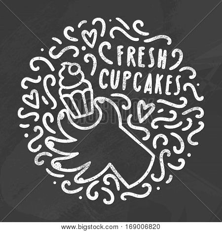 Hand holding cupcake and doodles. White chalk on the blackboard. Vector  illustration.