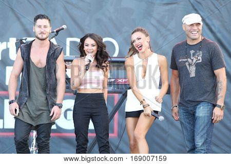 LAS VEGAS-SEP 20: (L-R) Val Chmerkovskiy, Janel Parris, Karina Smirnoff and Randy Couture at the 2014 iHeartRadio Music Festival at MGM Resorts Village on September 20, 2014 in Las Vegas, Nevada.