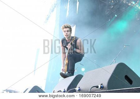 LAS VEGAS-SEP 20: Singer Luke Hemmings of 5 Seconds of Summer perform in concert at the 2014 iHeartRadio Music Festival Village Show at MGM Resorts Village on September 20, 2014 in Las Vegas, Nevada.