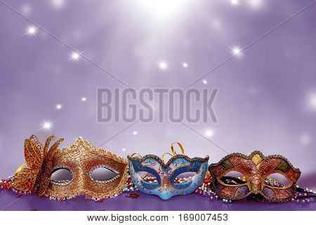 Traditional female carnival venetian masks  on table .Masquerade  masks on  glitter background.Mardi Gras