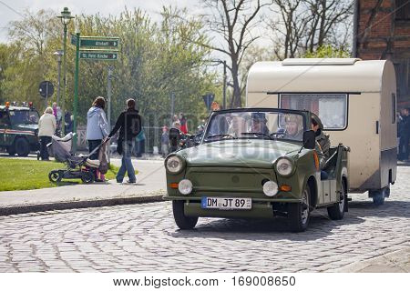 ALTENTREPTOW / GERMANY - MAY 1 2015: german trabant car with trailer drives on a street at oldtimer show on may 1 2015 in altentreptow germany.