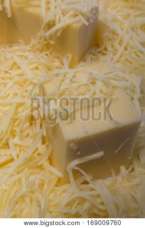 close-up background made of shredded yellow cheese, tasty and fresh