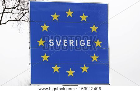 Sweden Boarder Sign with a grey background.