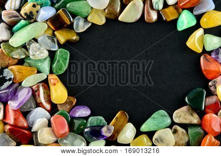Closeup colorful small stones on black background