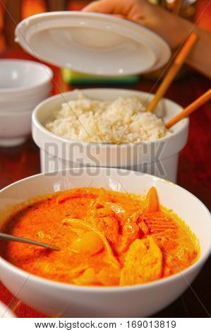 Curry Chicken With Rice Served In Bowl With Sticks