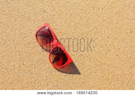 Red sunglasses on the sand beach, Thailand