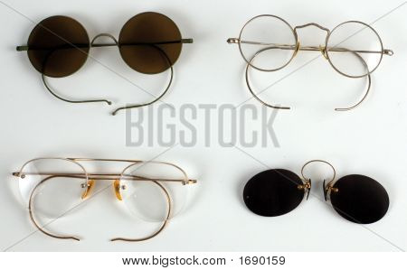 Four Old Pairs Of Glasses