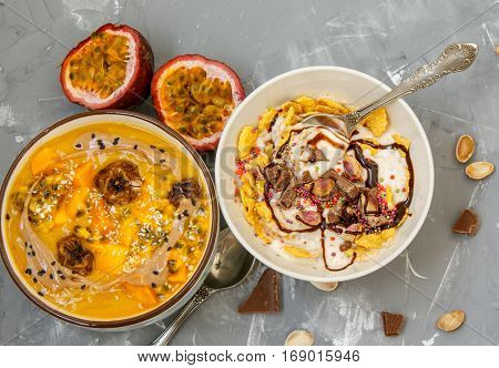 Vegan breakfast: smoothie bowls with chocolate and tropical fruits. Love for a healthy vegan food concept