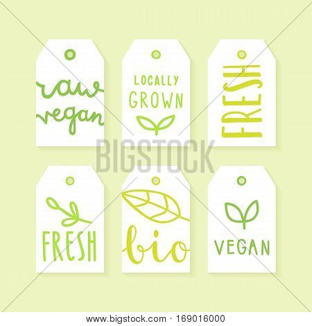Set of tags for packaging design. Raw, vegan, fresh, bio, locally grown. Vector hand drawn illustration