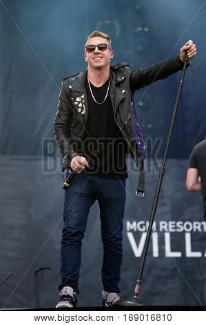 LAS VEGAS-SEP 20: Rapper Macklemore performs in concert at the 2014 iHeartRadio Music Festival Village Show at MGM Resorts Village on September 20, 2014 in Las Vegas, Nevada.