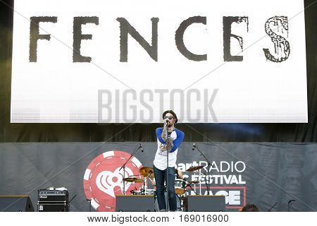 LAS VEGAS-SEP 20: Christopher Mansfield of Fences performs in concert at the 2014 iHeartRadio Music Festival Village Show at MGM Resorts Village on September 20, 2014 in Las Vegas, Nevada.