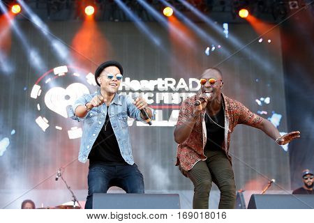 LAS VEGAS-SEP 20: Nicolas Sereba (L) and Vincent Dery aka Nico and Vinz perform at the 2014 iHeartRadio Music Festival Village Show at MGM Resorts Village on September 20, 2014 in Las Vegas, Nevada.