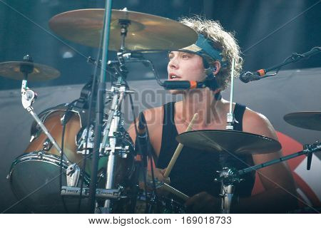 LAS VEGAS-SEP 20: Drummer Ashton Irwin of 5 Seconds of Summer performs in concert at the 2014 iHeartRadio Music Festival Village Show at MGM Resorts Village on September 20, 2014 in Las Vegas, Nevada.