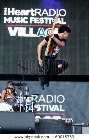 LAS VEGAS-SEP 20: Musician Calum Hood of 5 Seconds of Summer performs in concert at the 2014 iHeartRadio Music Festival Village Show at MGM Resorts Village on September 20, 2014 in Las Vegas, Nevada.