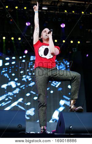 LAS VEGAS-SEP 20: Singer Tyler Glenn of Neon Trees performs in concert at the 2014 iHeartRadio Music Festival Village Show at MGM Resorts Village on September 20, 2014 in Las Vegas, Nevada.