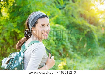 Beautiful asian woman with backpack walking outdoor