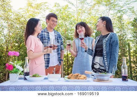 Young asian people drinking wine in party