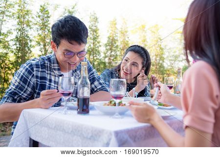 Young asian people eating meal in party