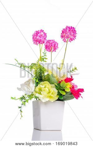 Artificial flower in flower pot isolated over white