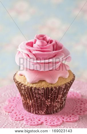 Cupcake with sweet rose flower