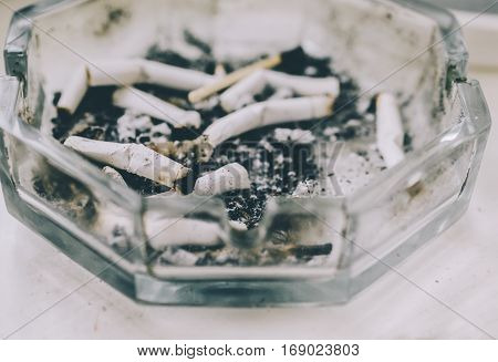 Cigarette butts on a gray dirty background