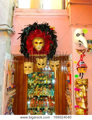 Venice, Italy - May 10, 2014: Venetian carnival masks, souvenir shop on a street of Venice, Veneto, Italy on May 10, 2014