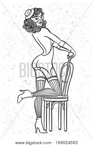 Beautiful female dancer wearing a cabaret style stocking gloves mask and lingerie. Posing standing on a vintage chair. poster