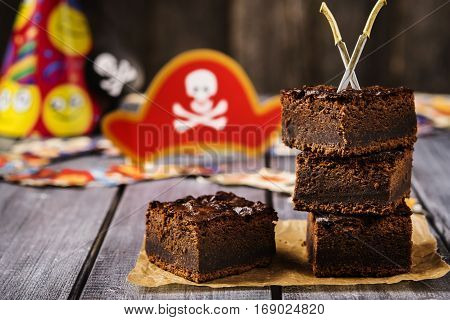 Chocolate brownie. Treats for children's holiday. Pirate Party. Selective focus