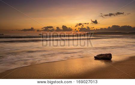 A colourful orange glow sunrise over the south China sea off the coast of Vietnam.