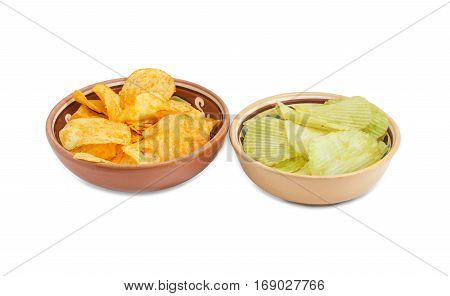 Potato chip flavored paprika and wasabi in two different ceramic bowls on a light background