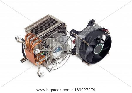 One active CPU cooler with large finned heatsink fan copper thermal pad with heat pipes one cooler with fan and aluminum finned heatsink on a light background
