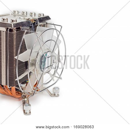 Fragment of the active CPU cooler with large finned heatsink fan copper thermal pad with a heat pipes closeup on a light background