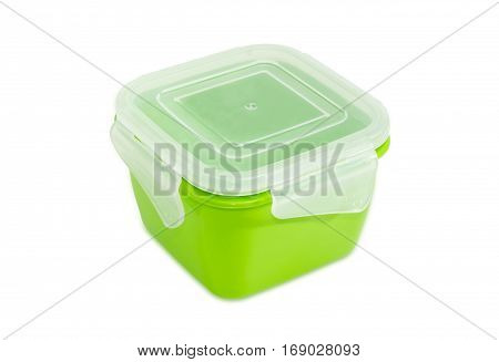 Green reusable plastic food storage container with translucent cover for home use on a light background
