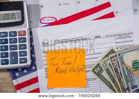 Text Tax Time On Tax Form With Flan, Money And Calculator.