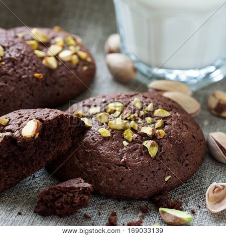 Homemade chocolate cookies with pistachios and milk square image
