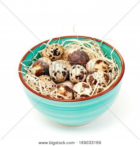 Close up of spotted easter eggs in bowl isolated on white