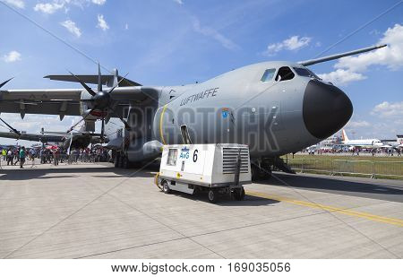 BERLIN / GERMANY - JUNE 3 2016: german Airbus A 400 M stands on airport schoenefeld / berlin. The Airbus A400M is a multi-national four-engine turboprop military transport aircraft.