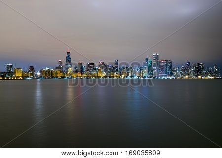Chicago's Skyline at night as seen from the Adler Planetarium by Lake Michigan.