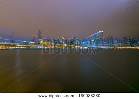Shot of purposely blurry Chicago skyline at night.