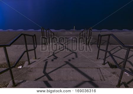 A shot of stairs going downwards into Lake Michigan by Adler Planetarium in Chicago Illinois.