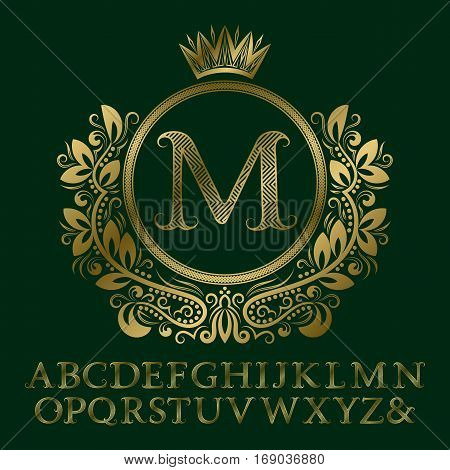 Zigzag striped gold letters and initial monogram in coat of arms form with crown. Elegant font and elements kit for logo design.