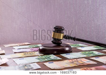 Law Gavel With Euro On Wooden Desk