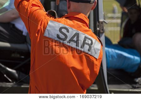 BERLIN / GERMANY - JUNE 3 2016: SAR ( Search and Rescue ) logo on a pilot from a rescue helicopter. SAR is the search for and provision of aid to people who are in distress or imminent danger.