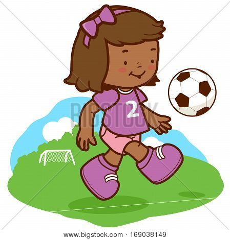 Little girl soccer player kicking a ball on the playing field.