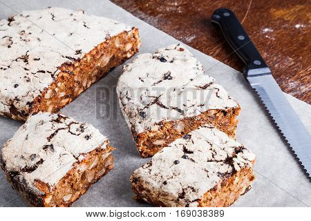 Freshly baked homemade rye gingerbread with nuts and dried fruits closeup