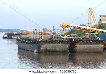 Loading Pier and Boats on River Side