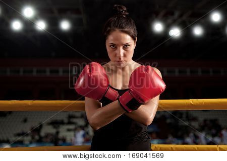 Portrait of woman training gym boxing mma ring
